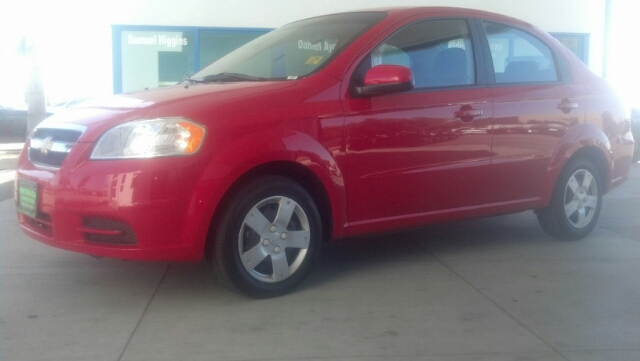 2011 CHEVROLET AVEO LS red we will protect your investment  with a warranty  for up to 3000 miles