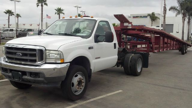 2003 FORD F450 white this is a nice truck if u want to start your own business or just expand your